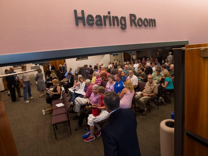 The hearing room is packed with people before a Larimer