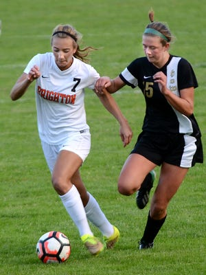 Brighton's Emma Shinsky (left) had two goals in the Bulldogs' 4-0 win over Hartland to win a district championship.