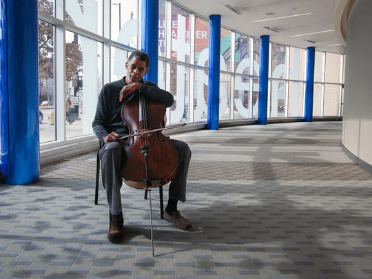 Norman Johns, CSO assistant principal cellist, inside the School for Creative and Performing Arts. Johns has taught at SCPA for more than 30 years and inspires minority students to play and achieve higher goals, as he did.