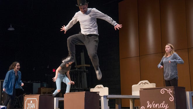 Learning to fly: Peter Pan (Alyssa Chechak), at right teaches the Darling children, John (Ian Danaher), Wendy (Michelle Quesada), and Michael (Grace LoGrasso) how to fly.