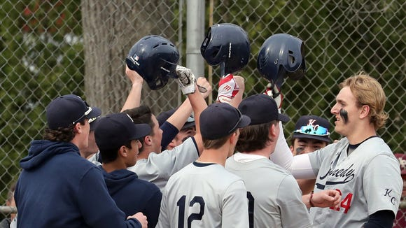 Eric Volpi of Kennedy Catholic is congratulated after hitting a solo home run in the second inning of a varsity baseball game against Iona Prep at Iona Prep April 24, 2018. Kennedy defeated Iona Prep 2-1 in nine innings.