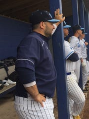 D.J. Gore surveys the scene from the Highland dugout during Monday's Tri-County Conference game against Clearview.