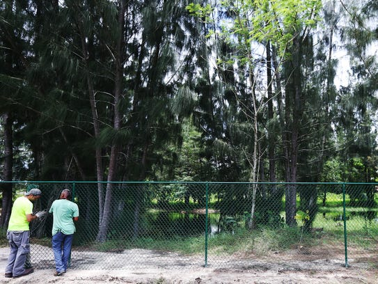 Fencing is put up Thursday around the Home-a-rama site