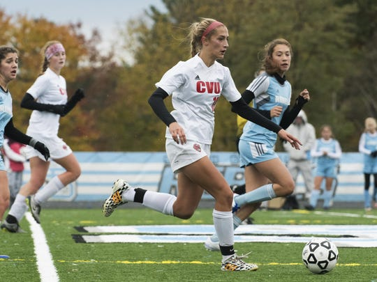 CVU's Abba Weimer (10) runs down the field with the ball during the girls high school playoff game between the Champlain Valley Union Redhawks and the South Burlington Rebels at South Burlington High School on Saturday afternoon October 29, 2016 in South Burlington.