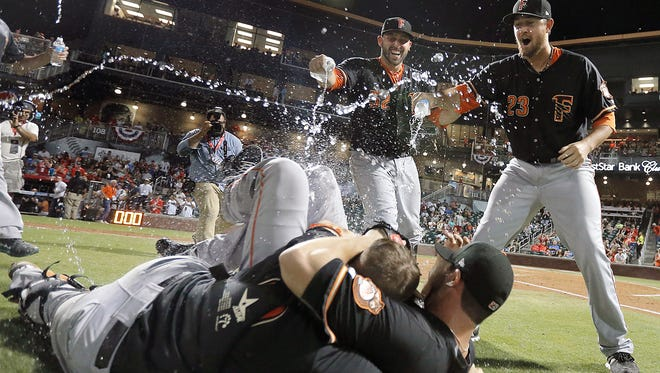 The Fresno Grizzlies celebrate their Gildan Triple-A Baseball National Championship after defeating Columbus 7-0 at Southwest University Park on Tuesday in Downtown El Paso.