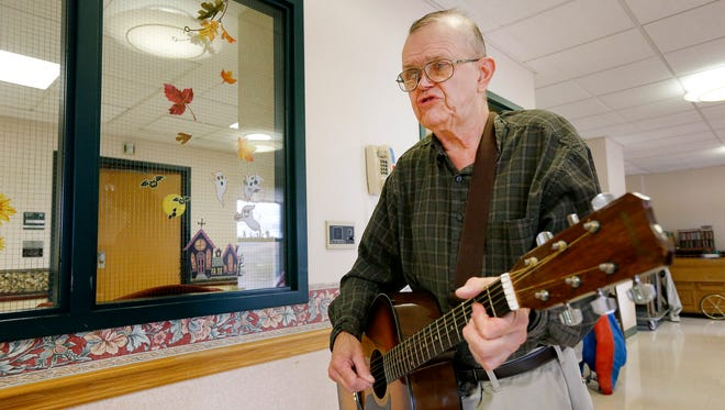 Donie Orton sings a country song Friday to residents of St. Joseph Hospital's skilled nursing facility in Elmira.