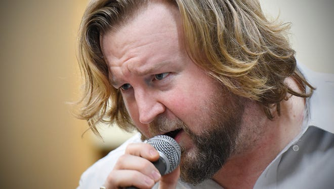 Grant F. Haake sings during a Monday, Dec. 7, rehearsal with a Meat Loaf tribute band.