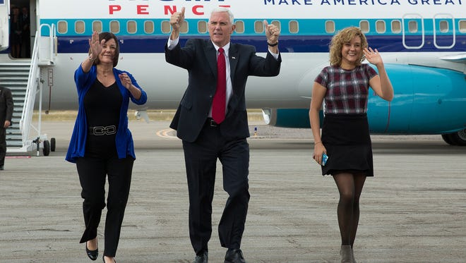Vice Presidential Candidate, Gov. Mike Pence, his wife Karen, left and daughter, Charlotte, walk toward the crowd of over 800 people that had gathered at Las Cruces International Airport, to hear Pence speak. Wednesday November 2, 2016, in Las Cruces. Pence is set to speak in Artesia Aug. 21 on the benefits of the United States-Mexico-Canada Agreement.