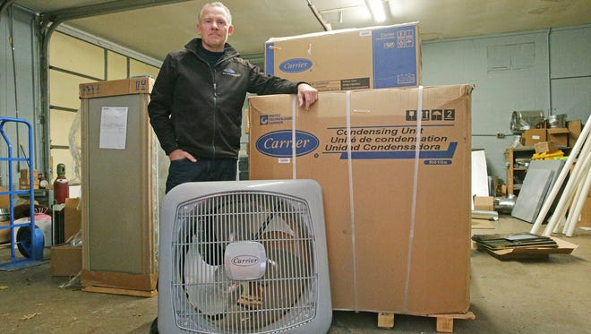 Jim Snyder, the owner of Irish Air Heating and Cooling, posed Wednesday, Dec. 21, 2016, in his warehouse. Snyder's company is among several independent heating and air conditioning dealers that specialize in Carrier products and faced ire from customers after Carrier said it was relocating Indianapolis jobs to Mexico.