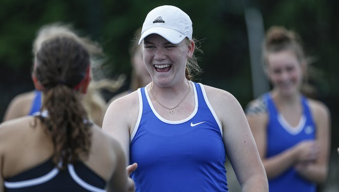 Carmel's Kiersten Carlson will help lead the Greyhounds toward state finals. Here, she shakes hands with an opponent before sectional finals on Thursday, May 18, 2017.