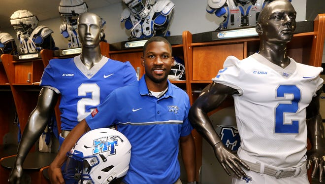 Larry Maples, the MTSU assistant athletic director for equipment operations, is shown in the locker room on Monday, Aug. 7, 2017, with the new uniforms that he designed for the team.