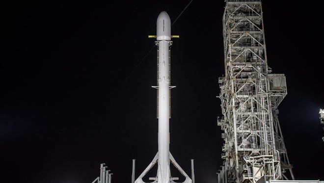 A SpaceX Falcon 9 rocket carrying the U.S. government's secret Zuma mission stands vertical on Kennedy Space Center's launch pad 39A. The rocket launch was delayed Thursday, Nov. 16, 2017.