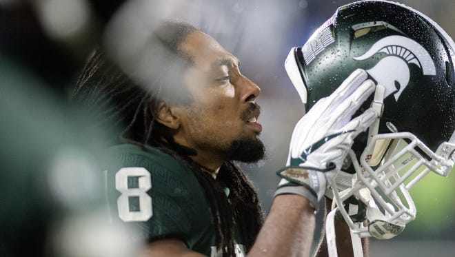 Michigan State receiver Felton Davis III puts his helmet on before the end of a timeout during the fourth quarter on Saturday, November 18, 2017, at Spartan Stadium in East Lansing.