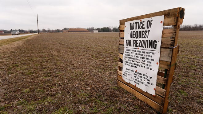 Notice of request for rezoning posted in a field off Dayton Road Wednesday, February 21, 2018, just south of Dayton.