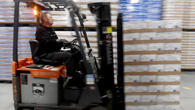 A warehouse worker moves merchandise at Central Distributors on Airways Boulevard in Jackson in 2018.