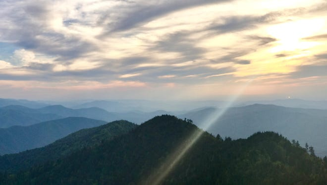 The sun shines down on the Smoky Mountains from Cliff Tops on Mount Leconte in June 2017.