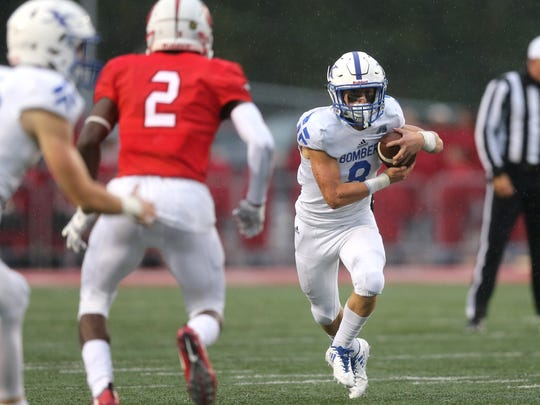 St. Xavier running back Cameron Specht (8) makes a cash out of the backfield in the first quarter during the high football game between the St. Xavier Bombers and the Colerain Cardinals, Friday, Sept. 1, 2017, at Colerain High School in Colerain Township.