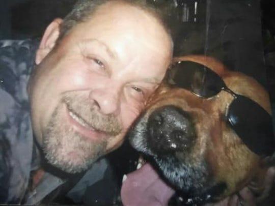 Danny Davis with his dog Buddy.