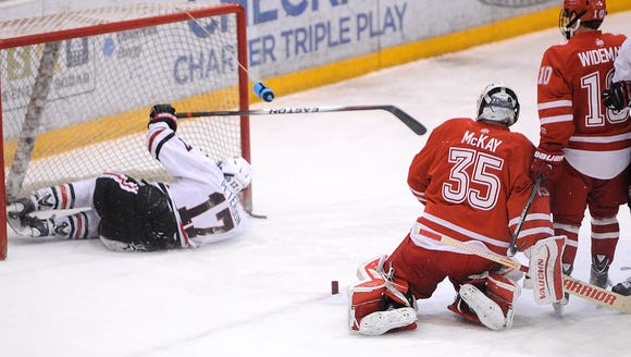St. Cloud State's Judd Peterson slides into the Miami