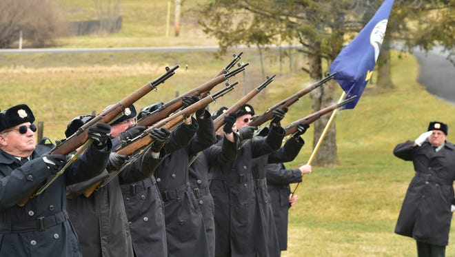 Veterans of Foreign Wars Post 1599 Honor Guard fire volleys during the funeral of Martin Senn at Green Hill Cemetery on Friday, March 4, 2016. Senn, a 20-year military veteran, died seven months ago at age 91. His body was unclaimed and his estate no administered. Franklin County coroner Jeff Conner became the administrator of the will. Conners administration fees from the estate will go toward cremating other unclaimed remains in the future.