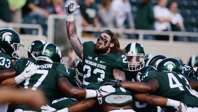 Junior linebacker Chris Frey (23) fires up MSU's linebackers before a 2016 game against Wisconsin.