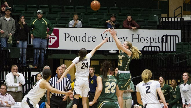Colorado State guard Ellen Nystrom (13) fires the game-winning shot to beat CU last season. The Rams play the Buffs in Boulder on Thursday.