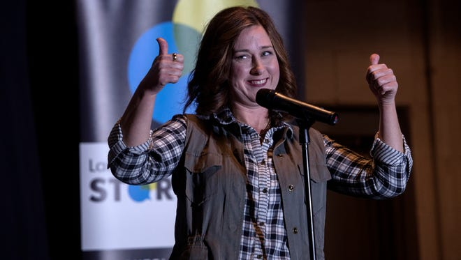 Elyse Kopietz speaks during the Lansing Storytellers Project: 'I Was Wrong' on Tuesday, Nov. 14, 2017, at the Lansing Brewing Company in Lansing.