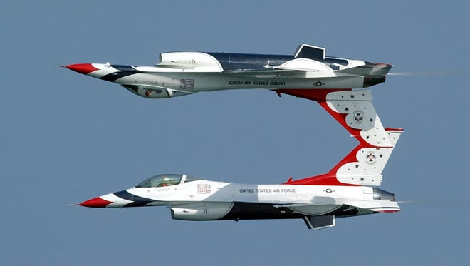 -The Thunderbirds fly their F-16C/D's upside-down as they gain altitude, Sunday, May 4, 2003, at the 2003 Air and Sea show in Fort Lauderdale, Fla.