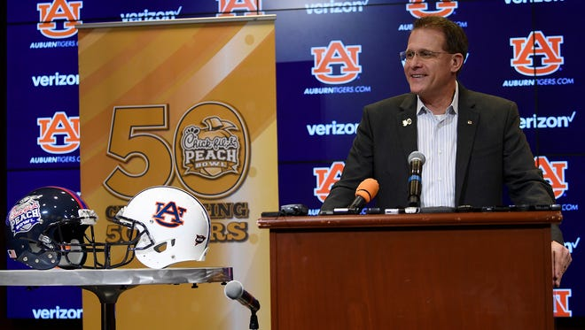 Auburn head coach Gus Malzahn talks at the Chick-fil-A Peach Bowl presser on Wednesday, Dec. 13, 2017 in Auburn, Ala.