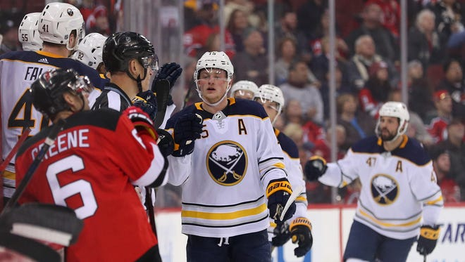 Buffalo Sabres center Jack Eichel (15) celebrates his goal during the second period of their game against the New Jersey Devils at Prudential Center on Friday, Dec. 29, 2017.