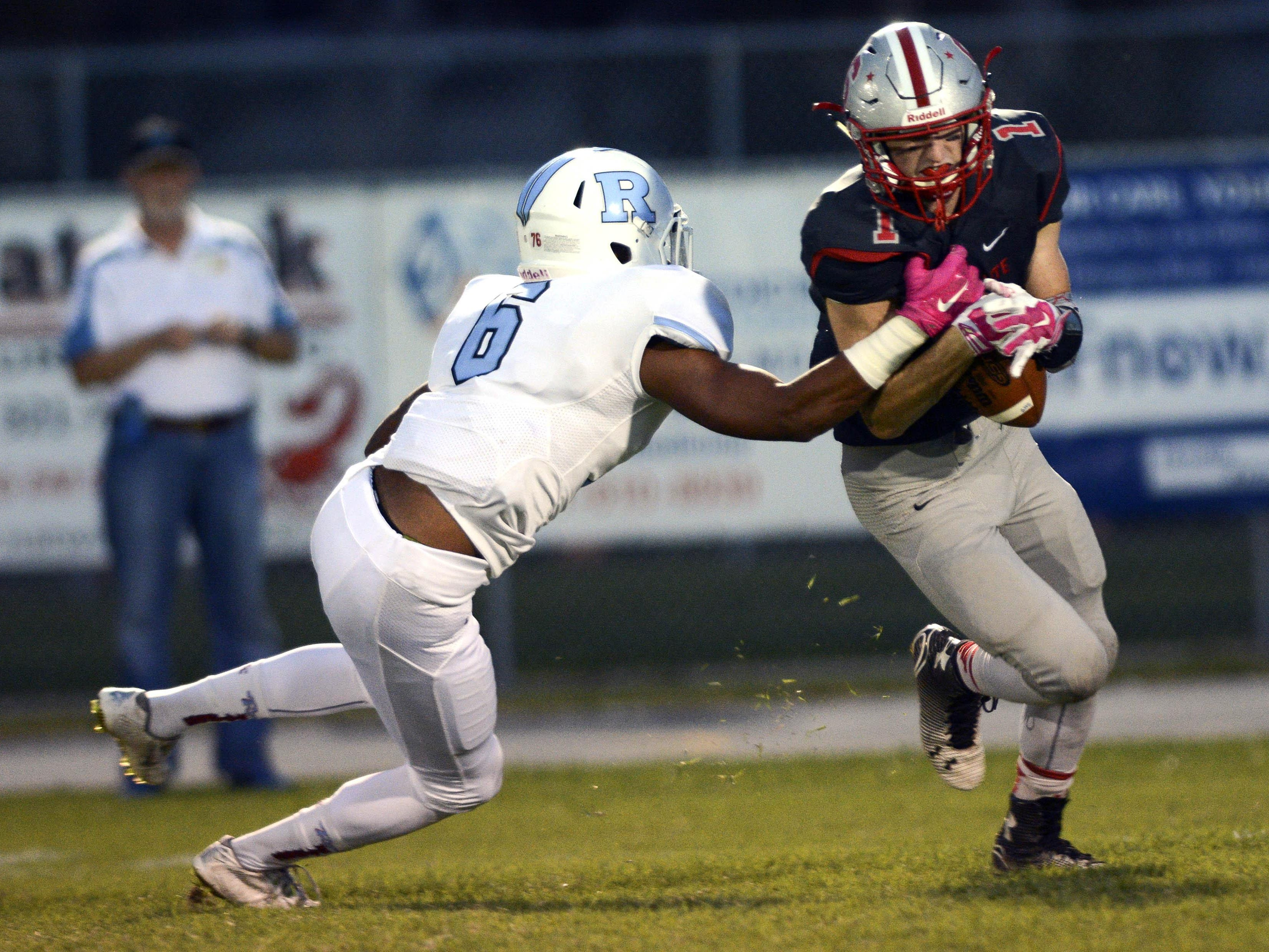 Alex Nicks of Satellite tries to hang onto the ball as Rockledge's Justin Gonzalez (6) tries to dislodge it during Friday's game in Satellite Beach.