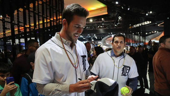 Tigers pitcher Drew VerHagen, left, and outfielder Mikie Mahtook signed balls and hats during the 2017 North American International Auto Show on Friday, Jan. 20 at Cobo Center.