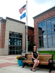 Courtney Pelot, Miss Wisconsin 2016, sits in front of her hometown library, the Manitowoc Public Library.