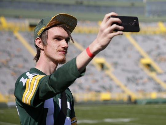 Luke Piff of Shrewsbury, England, and a member of the UK and Irish Packers fan group, takes photos during a stadium tour of Lambeau Field on Sept. 11, 2017 in Green Bay, Wis.