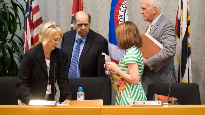 The Knox County school board chair Patti Bounds, left, alog with Mike McMillian, center, and Amber Rountree prepare to leave followed by school superintended Bob Thomas after the board approved the 2018-2019 budget on Monday, April 30, 2018.