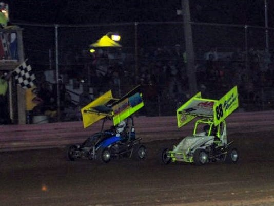 Brad Brown, left, just noses out Jesse Maurer in the final match race to set the lineup for the 270 Micro Sprint feature. Maurer ended up winning the feature race.