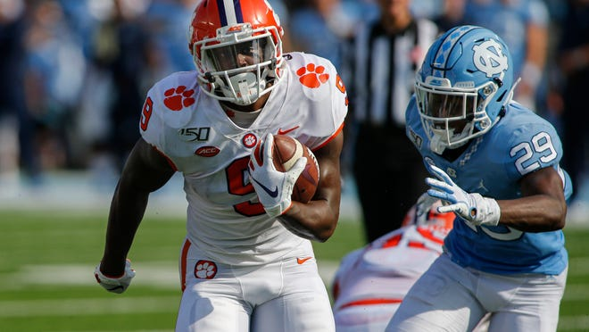 Sep 28, 2019; Chapel Hill, NC, USA; Clemson Tigers running back Travis Etienne (9) runs for a touchdown past North Carolina Tar Heels defensive back Storm Duck (29) in the first half at Kenan Memorial Stadium. Mandatory Credit: Nell Redmond-USA TODAY Sports