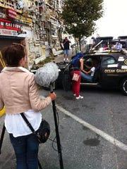 "Crew members of Russian film ""Turbo"" shoot movie scenes involving the Ocean Gallery's Batmobile."