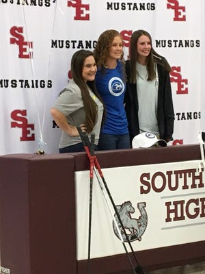 South Effingham golfer Abbie Cheney, middle, poses with teammates Bella Sapp, left, and Hannah Smith, right, after signing to play golf with Shorter University.