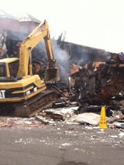 Demolition gets underway at the C-Town supermarket in South Amboy that was destroyed Monday in a four-alarm fire.