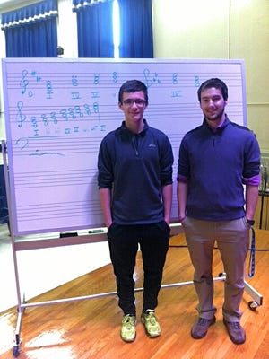 Ryan Brown (left) and Millville Memorial High School band director Joseph Sino after auditions for the Olympic Conference Honors Band.