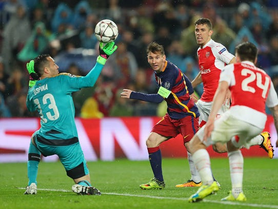 Lionel Messi of Barcelona scores his team's third goal