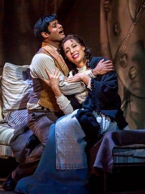 """Nicole Cabell as Mimi and Sean Panikkar as  Rodolfo in Michigan Opera Theatre's production of Puccini's """"La Boheme."""""""