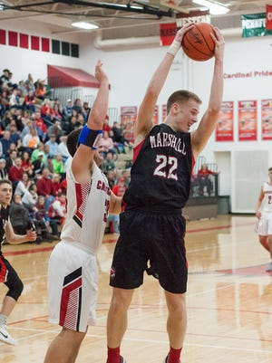Marshall's,Jeremy Luciani collects a rebound against Coldwater on Friday.