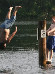 Two boys took turns diving off a piling at Wildcat Lake Wednesday afternoon.