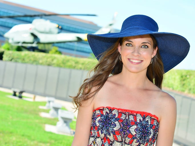 Valerie Shimmin models maxi dress, $39.50, and Navy floppy hat, $24.50, International Boutique.For this story and more, see the July issue