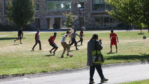Students play soccer on one of the lawns at Westchester Community College.