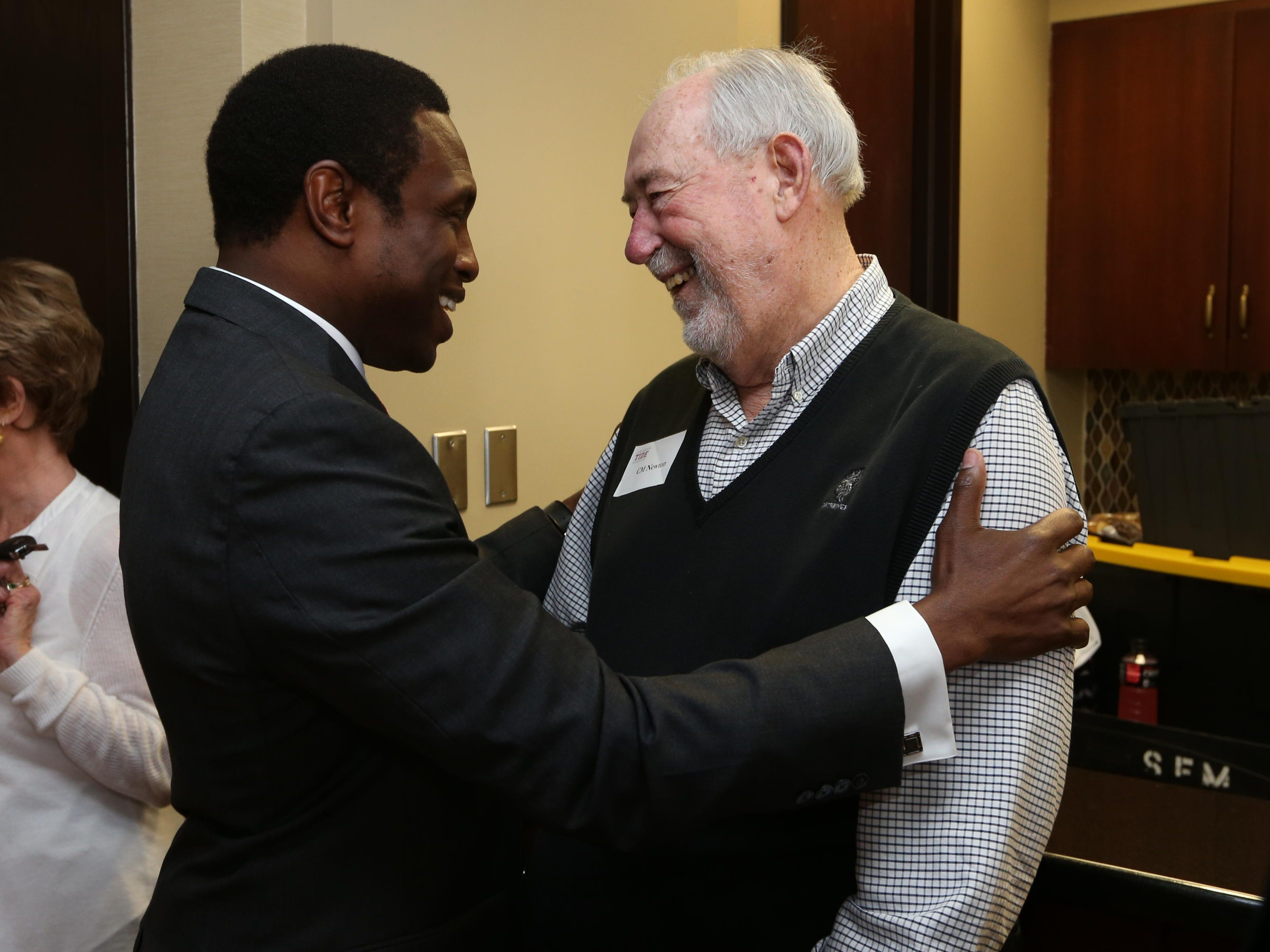 Avery Johnson greets C.M. Newton the day that Johnson was named Alabama's coach in April 2015.
