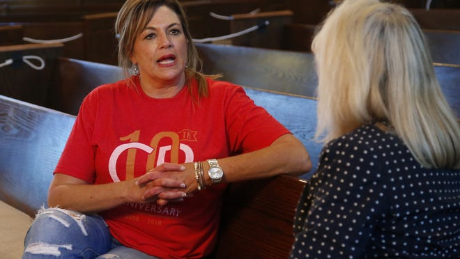 Teresa Stanfield, left, the Oklahoma field director with Virginia-based Prison Fellowship, talks with Teresa Peden, pastor of recovery at Crossing Community Church,  at the church in Oklahoma City.