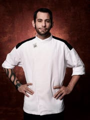 "Chef Genaro Delillo, of Lebanon, mans his station in FOX's ""Hell's Kitchen."" Delillo auditioned for the show and was chosen for Season 16, where he competed among 18 chefs."